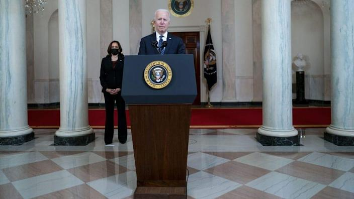 U.S. President Joe Biden makes remarks as Vice President Kamala Harris looks on in response to the verdict in the murder trial of former Minneapolis police officer Derek Chauvin at the Cross Hall of the White House April 20, 2021 in Washington, DC. (Photo by Doug Mills-Pool/Getty Images)