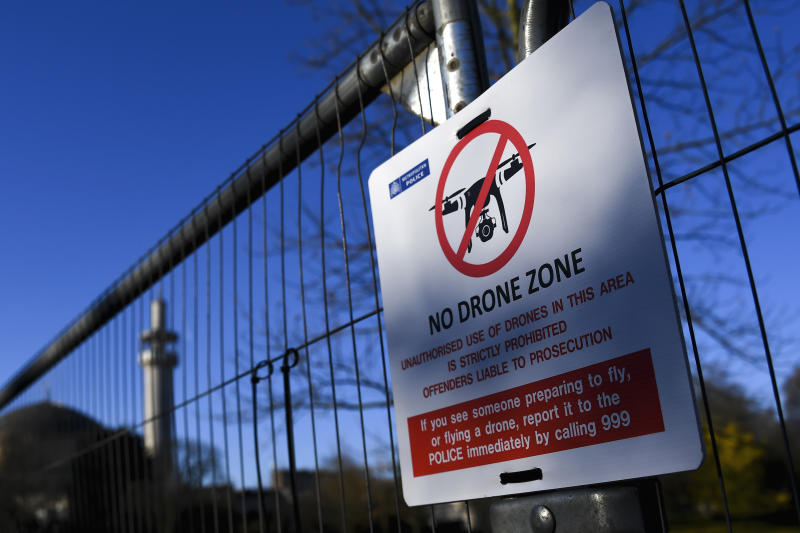 A No Drone Zone sign is posted on a fence which has been set up around Winfield House, the US Ambassador's residence as US President Donald Trump is set to arrive ahead of the NATO Summit in London, Monday, Dec. 2, 2019. U.S. President Donald Trump will gather with NATO's other leaders in London Tuesday as the world's biggest military alliance, marking its 70th birthday, battles with one of the most confounding of adversaries: Itself.  (AP Photo/Alberto Pezzali)