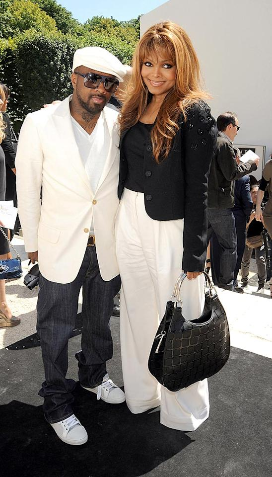 "Jermaine Dupri dons a white sportcoat and matching newsboy cap, while his lady love Janet Jackson opts for a cropped black blazer, high-waisted white pants, and the perfect purse. Dominique Charriau/<a href=""http://www.wireimage.com"" target=""new"">WireImage.com</a> - June 30, 2008"