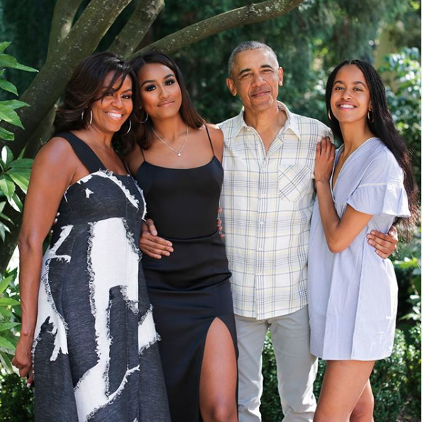 Sasha and Malia Obama look completely different in a photo shared to Michelle Obama's Twitter account. Photo: Twitter/Michelle Obama