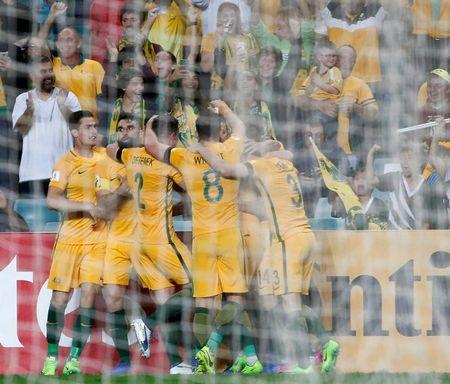 Football Soccer - Australia vs United Arab Emirates - 2018 World Cup Qualifying Asian Zone - Group B - Sydney Football Stadium, Sydney, Australia - 28/3/17 - Australia's players celebrate with Jackson Irvine (obscured) after Irvine scored a goal against the UAE.  REUTERS/David Gray