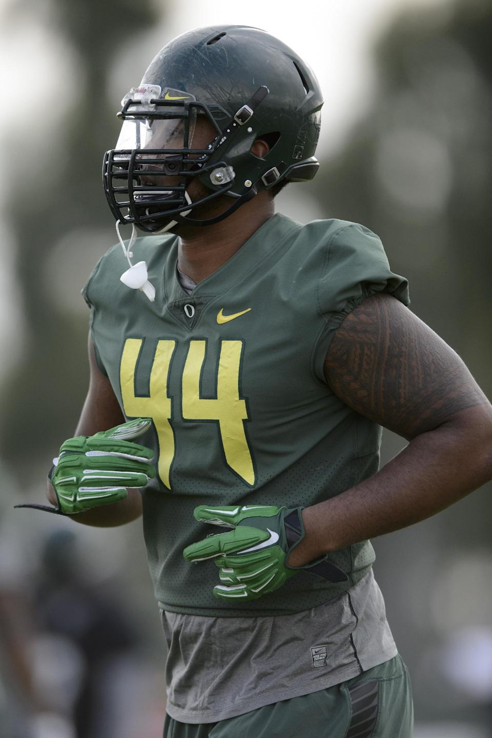 Oregon defensive lineman DeForest Buckner (44) jogs during NCAA college football practice in Carson, Calif., Tuesday, Dec. 30, 2014. Oregon is scheduled to play Florida State in the Rose Bowl NCAA college football playoff semifinal on New Year's Day. (AP Photo/Kelvin Kuo)