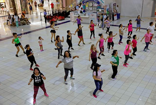 <p>Residents do their daily routine Zumba class inside a mall on the island of Guam, a U.S. Pacific Territory August 10, 2017. (Erik De Castro/Reuters) </p>