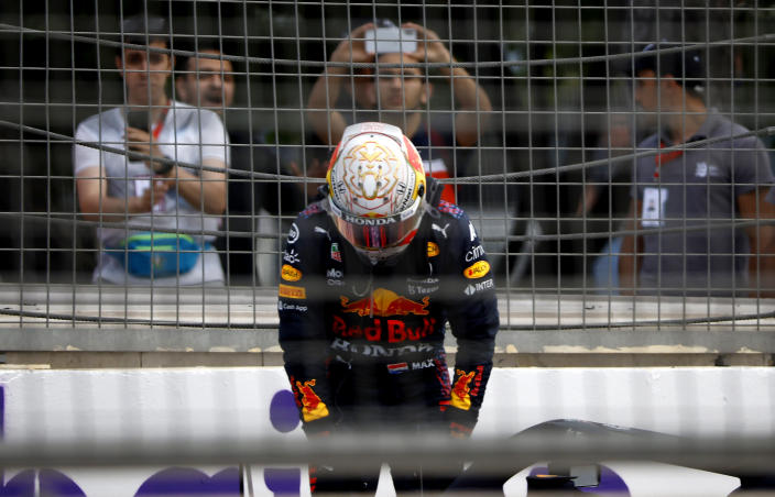 Red Bull driver Max Verstappen of the Netherlands is dejected after crashing out during the Formula One Grand Prix at the Baku Formula One city circuit in Baku, Azerbaijan, Sunday, June 6, 2021. (Maxim Shemetov, Pool via AP)