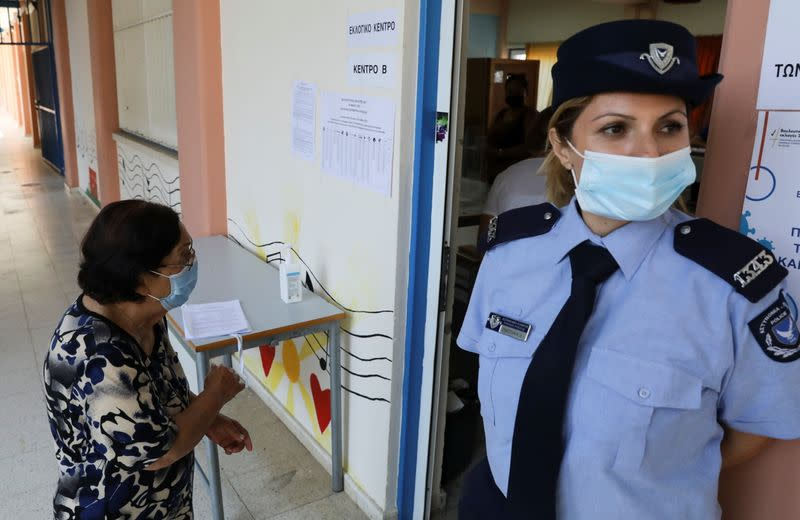 A woman waits to cast her vote during parliamentary elections at a polling station in Nicosia