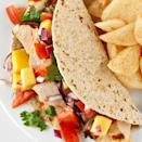 <p>You'll love these soft chicken tacos. The chicken is marinated in a lime-cumin mixture, grilled and then served with a refreshing mango salsa and thick grilled onion slices.</p>