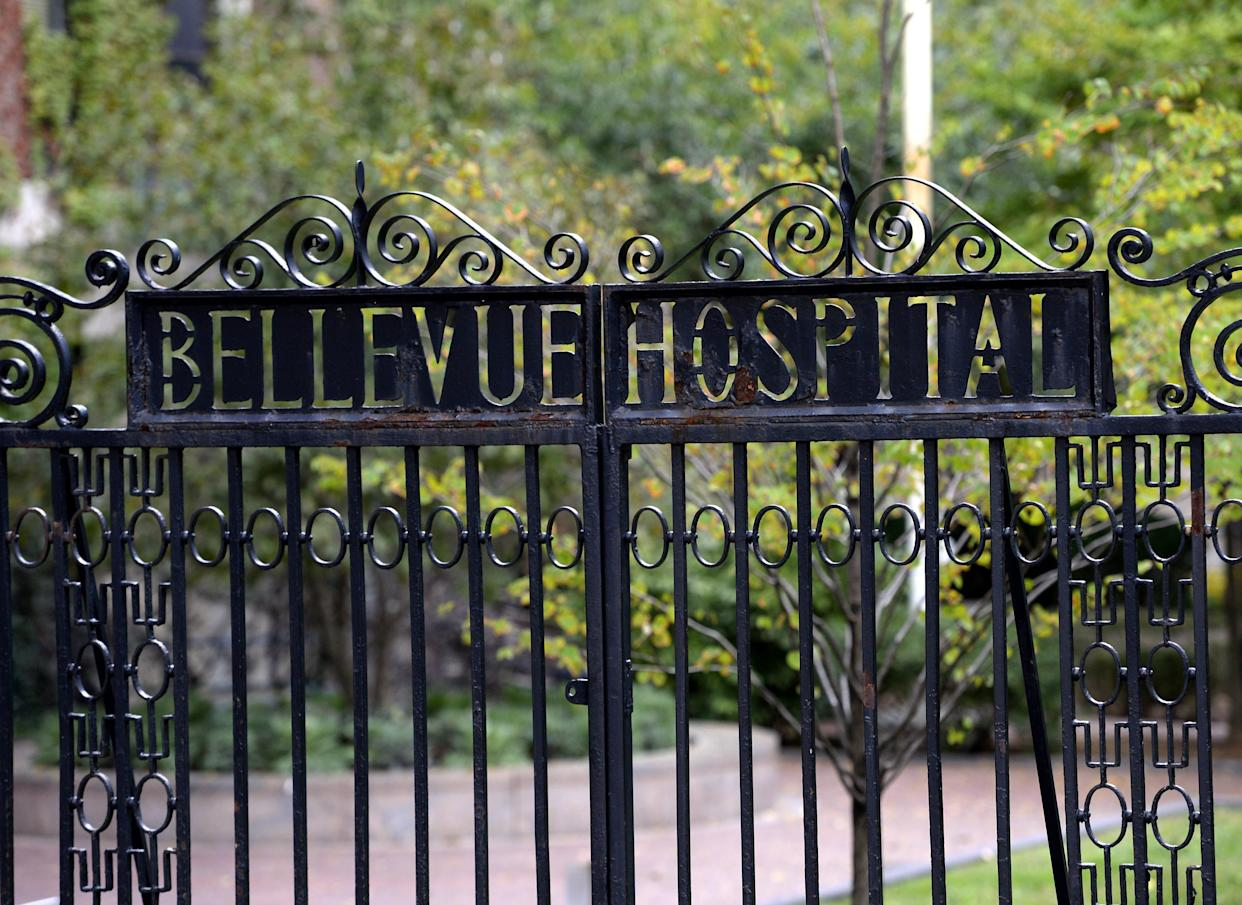 A sign on the gate for the entrance to Bellevue Hospital is viewed on October 24, 2014 in New York, the morning after it was confirmed that Craig Spencer, a member of Doctors Without Borders, who recently returned to New York from West Africa tested positive for Ebola.