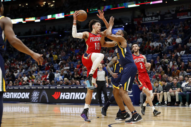 New Orleans Pelicans center Jaxson Hayes (10) is defended by Utah Jazz center Tony Bradley (13) in the first half of a NBA basketball game in New Orleans, Monday, Jan. 6, 2020. (AP Photo/Tyler Kaufman)