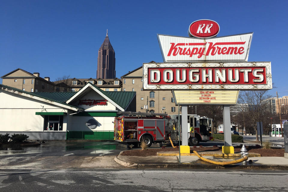 Firefighters work at the Krispy Kreme Doughnuts store owned by Shaquille O'Neal in Atlanta