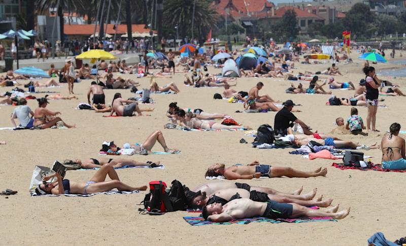 Residents in Melbourne may want to head to the beach when temperatures soar into the high 30s this week. Source: AAP