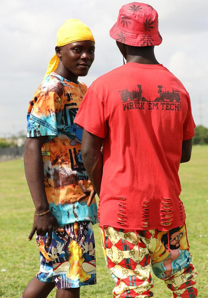 Two Fulani men in red and yellow clothes