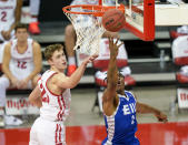 Eastern Illinois' Jordan Skipper-Brown (2) shoots against Wisconsin's Ben Carlson (20) during the first half of an NCAA college basketball game Wednesday, Nov. 25, 2020, in Madison, Wis. (AP Photo/Andy Manis)
