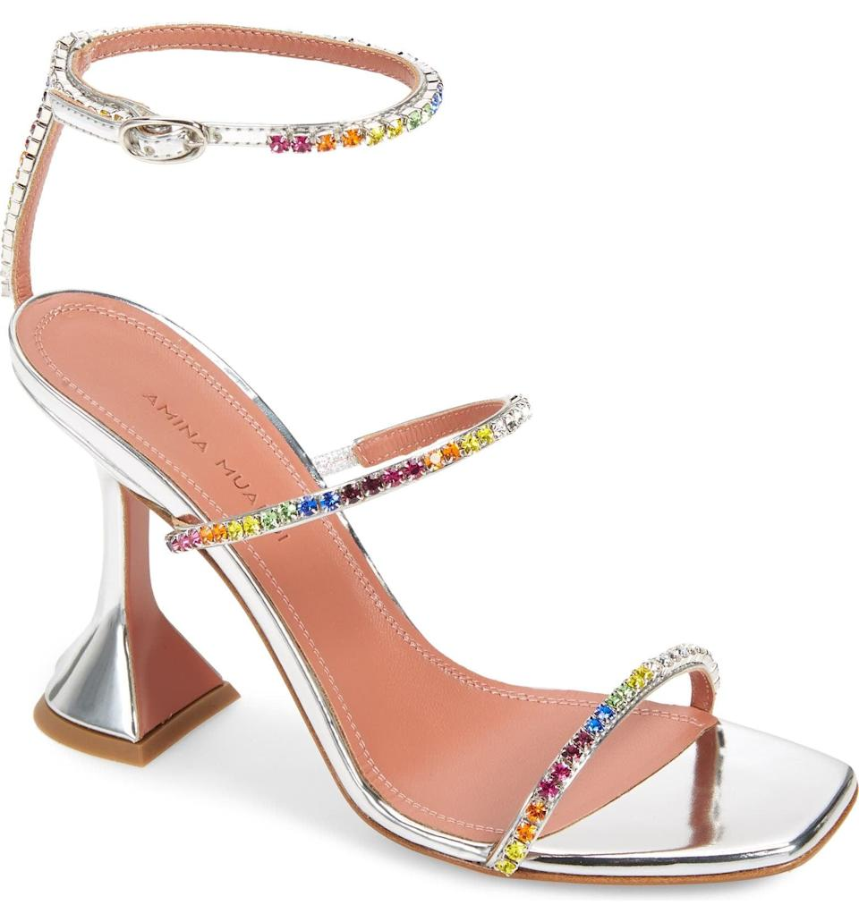 <p>When you want to smile, put your dancing shoes on, a.k.a. these <span>Amina Muaddi Gilda Sunset Rainbow Ankle Strap Sandals</span> ($1,090).</p>