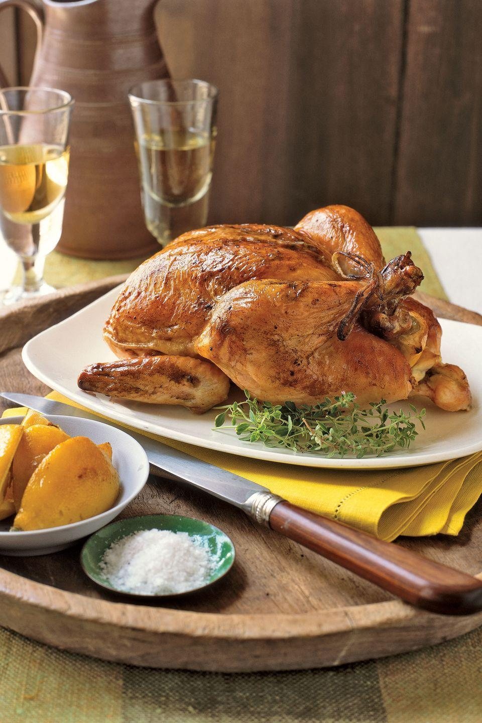 "<p>A lemon inserted into the chicken's cavity during roasting keeps the meat moist and juicy. Seasoning the skin with zest imparts flavor and salt makes it crisp.</p><p><strong><a href=""https://www.countryliving.com/food-drinks/recipes/a1562/roast-lemon-chicken-3677/"" rel=""nofollow noopener"" target=""_blank"" data-ylk=""slk:Get the recipe."" class=""link rapid-noclick-resp"">Get the recipe.</a></strong></p>"