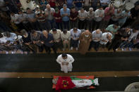 Palestinian mourners pray by the body of Rasheed Abu Arra who was killed in the clashes with Israeli forces during his funeral, in the Village of Aqqaba near the West Bank town of Tubas, Wednesday, May 12, 2021. (AP Photo / Majdi Mohammed)