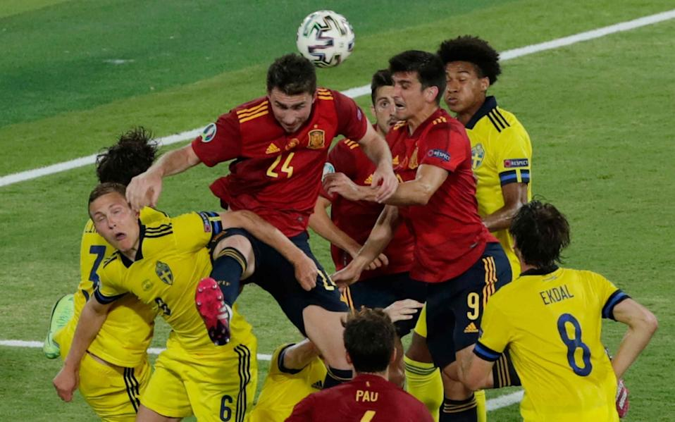Players vie for the header during the UEFA EURO 2020 Group E football match between Spain and Sweden at La Cartuja Stadium in Sevilla - AFP
