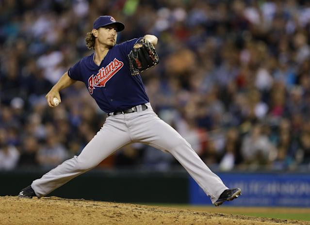 Cleveland Indians starting pitcher Josh Tomlin throws in the eighth inning of a baseball game against the Seattle Mariners, Saturday, June 28, 2014, in Seattle. (AP Photo/Ted S. Warren)