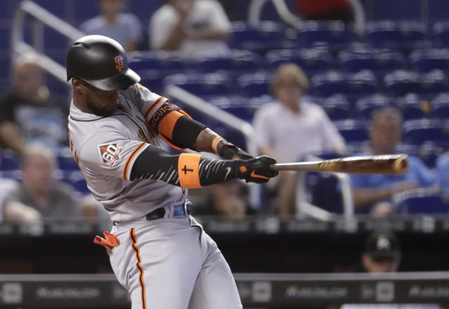 San Francisco Giants' Andrew McCutchen hits a two-run home run during the first inning of a baseball game against the Miami Marlins, Thursday, June 14, 2018, in Miami. (AP Photo/Lynne Sladky)