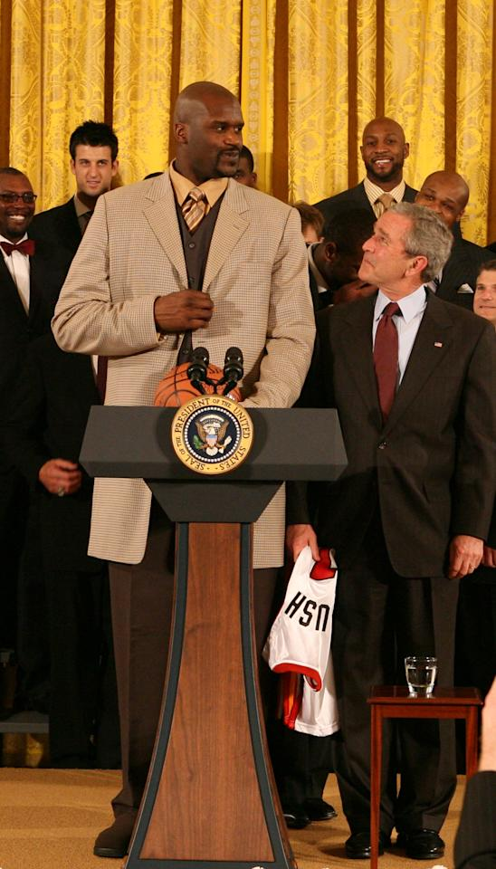 WASHINGTON - FEBRUARY 27:  Shaquille O'Neal (L) of the Miami Heat speaks with President George W. Bush during the 2006 NBA Champions Miami Heat visit to the White House on February 27, 2007 in Washington, D.C. NOTE TO USER: User expressly acknowledges and agrees that, by downloading and/or using this Photograph, user is consenting to the terms and conditions of the Getty Images License Agreement. Mandatory Copyright Notice: Copyright 2007 NBAE (Photo by Nathaniel S. Butler/NBAE via Getty Images)