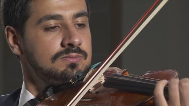Sari Alesh, a Syrian refugee and violinist, is reviving his musical career in his new home in Victoria.