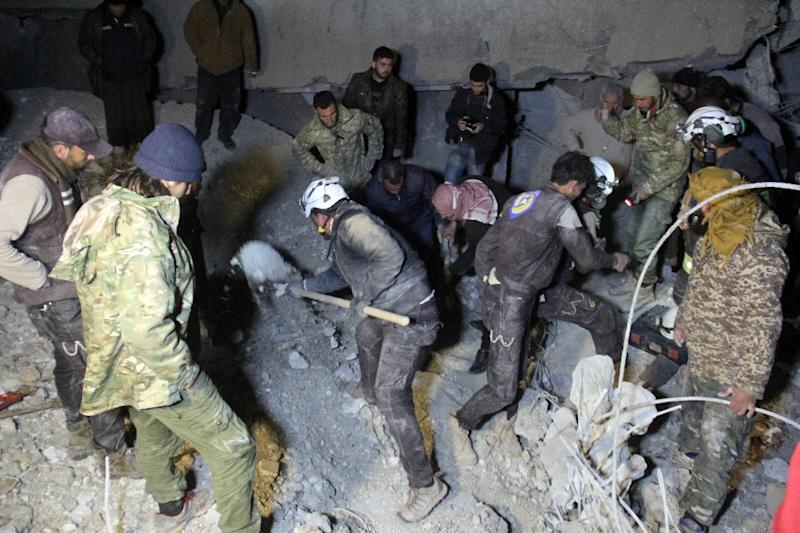 Syrian civil defence volunteers, known as the White Helmets, dig through the rubble of a mosque following a US air strike on the village of Al-Jineh late on March 16, 2017 (AFP Photo/Omar haj kadour)