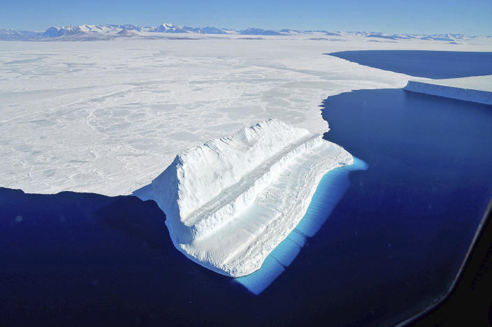 The frigid Antarctic region is an expanse of white ice and blue waters, as pictured in March, 2017, at the U.S. research facility McMurdo Station. NASA's Operation IceBridge has collected annual measurements of Antarctic ice to track changes and help predict sea level rise. (Chris Larsen/NASA via AP) / Credit: Chris Larsen / AP