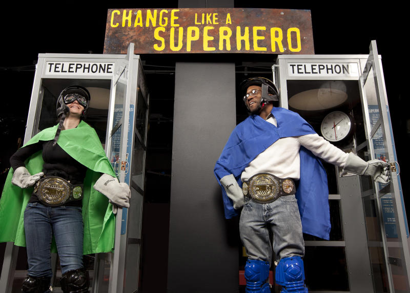 """In this Feb. 17, 2012 photo provided by the Museum of Science and Industry, friends and relatives come out of phone booths during setup for the """"Change Like A Superhero"""" station of the """"MythBusters: The Explosive Exhibition"""" exhibit modeled after Discovery Channel television show """"Mythbusters"""" at the Museum of Science and Industry in Chicago. The exhibit opens Thursday, March 15 and runs through Sept. 3. The planned national tour that will include stops at several other U.S. cities. (AP Photo/Museum of Science and Industry, J.B. Spector)"""