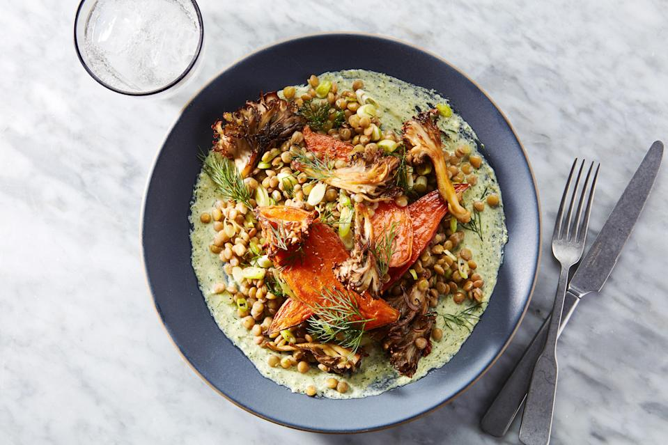 """This hearty sweet potato dinner gets tons of flavor and texture from crispy mushrooms, tender lentils, and an herby feta-tahini sauce. <a href=""""https://www.epicurious.com/recipes/food/views/sweet-potato-dinner-with-mushrooms-lentils-and-feta-tahini-sauce?mbid=synd_yahoo_rss"""" rel=""""nofollow noopener"""" target=""""_blank"""" data-ylk=""""slk:See recipe."""" class=""""link rapid-noclick-resp"""">See recipe.</a>"""
