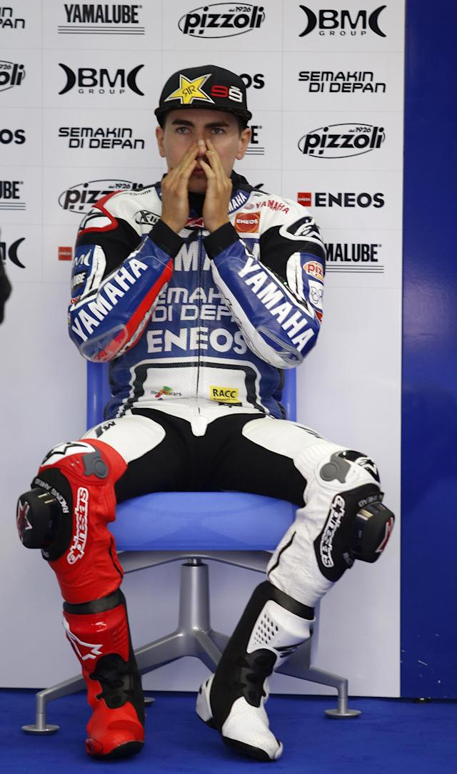 Fiat Yamaha team's Spanish rider Jorge Lorenzo gestures inside the pit during the Moto GP Training session of the Valencia Grand Prix at Ricardo Tormo racetrack in Cheste, on November 9, 2012. AFP PHOTO/ JOSE JORDANJOSE JORDAN/AFP/Getty Images