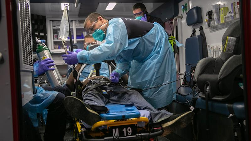 Houston Fire Department medics transport a man to a hospital after he suffered cardiac arrest on August 11, 2020 in Houston, Texas. Heart failure is a frequent result of COVID-19. (John Moore/Getty Images)