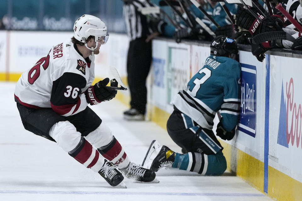 San Jose Sharks left wing John Leonard (43) collides against the boards as Arizona Coyotes right wing Christian Fischer (36) watches during the first period of an NHL hockey game Friday, May 7, 2021, in San Jose, Calif. (AP Photo/Tony Avelar)