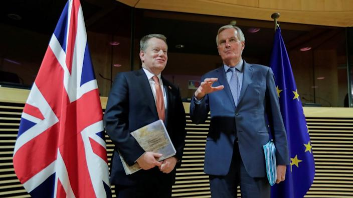 Lord David Frost (left) and Michel Barnier (right