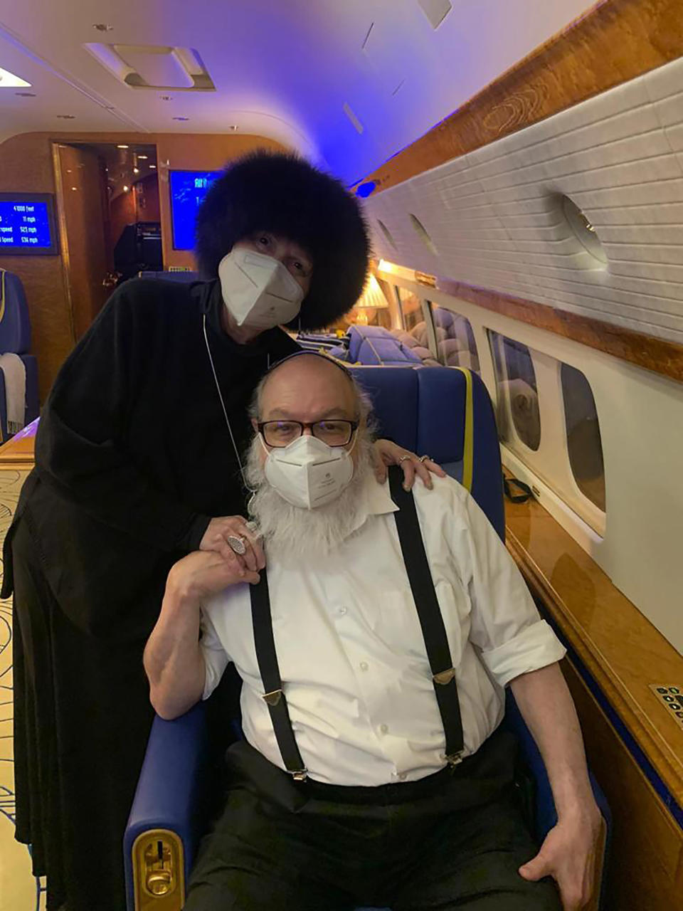 Jonathan Pollard and his wife Esther sit inside a private plane provided by American casino magnate Sheldon Adelson, on route to land in Ben Gurion International airport near Tel Aviv, Israel, Wednesday, Dec. 30, 2020. Pollard, who spent 30 years in U.S. prison for spying for Israel, arrived in Israel early Wednesday with his wife, triumphantly kissing the ground as he disembarked from the aircraft in the culmination of a decades-long affair that had long strained relations between the two close allies. (AP Photo/Israel Hayom)