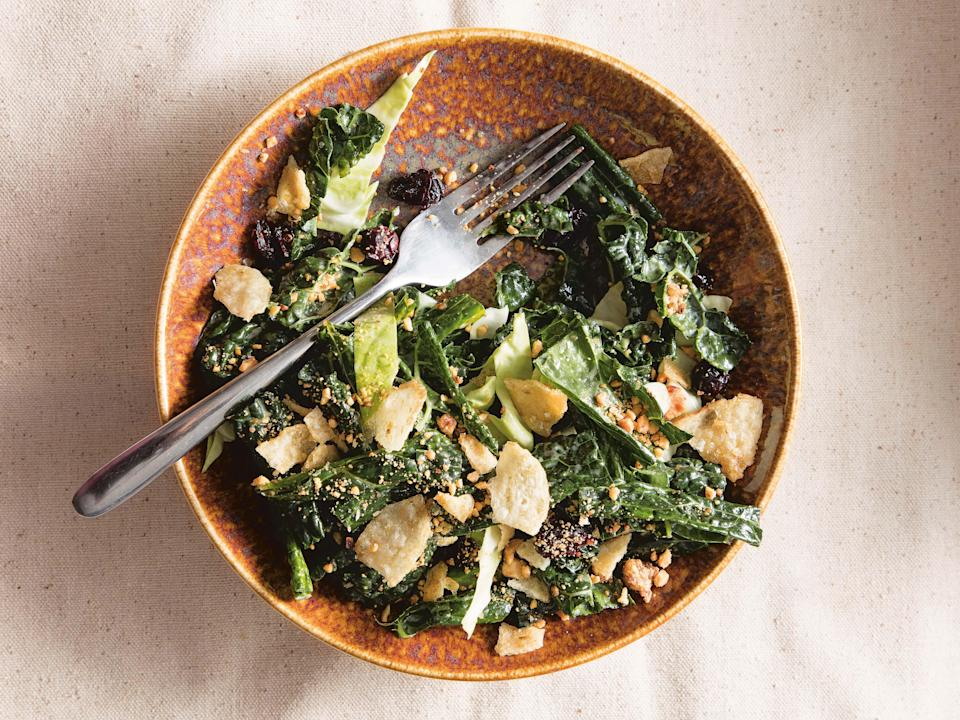 """It's hard to say whether it's the sweet onion dressing, the crumbled potato chips, or the kim chee peanuts on this kale salad that make it superlative, but it will be easily voted most popular on the picnic blanket. <a href=""""https://www.epicurious.com/recipes/food/views/maui-kale-salad-with-sweet-onion-dressing-sheldon-simeon-cook-real-hawaii?mbid=synd_yahoo_rss"""" rel=""""nofollow noopener"""" target=""""_blank"""" data-ylk=""""slk:See recipe."""" class=""""link rapid-noclick-resp"""">See recipe.</a>"""