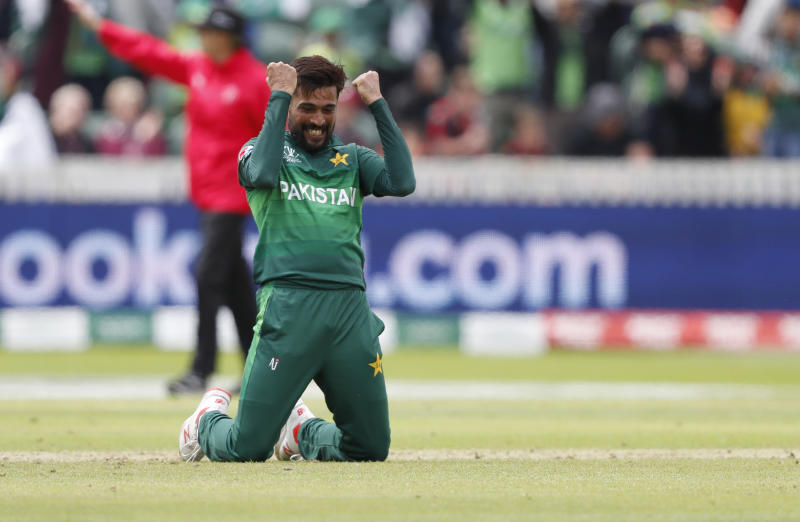 Pakistan's Mohammad Amir celebrates after taking the wicket of Australia's Mitchell Starc during the Cricket World Cup match between Australia and Pakistan at the County Ground in Taunton, south west England, Wednesday, June 12, 2019. (AP Photo/Alastair Grant)