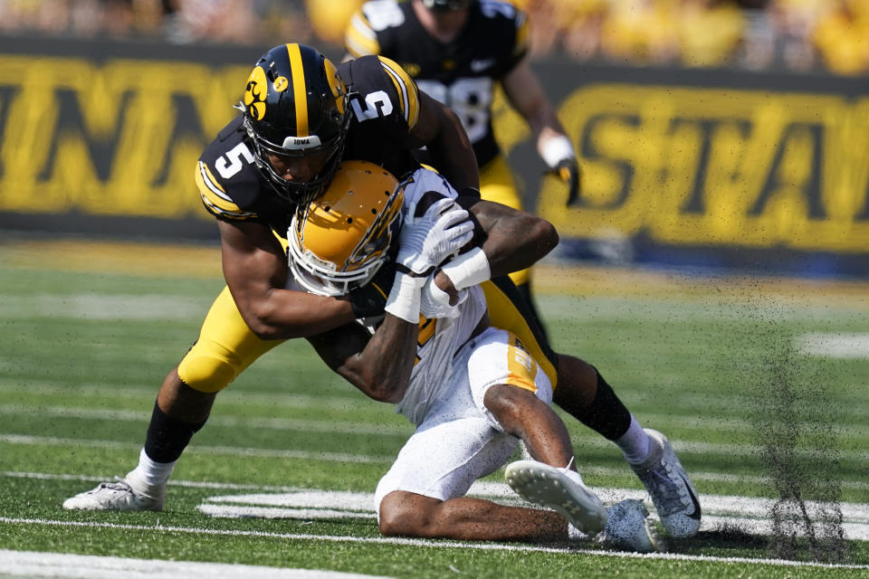 Kent State wide receiver Dante Cephas (14) is tackled by Iowa linebacker Jestin Jacobs (5) after catching a pass during the first half of an NCAA college football game, Saturday, Sept. 18, 2021, in Iowa City, Iowa. (AP Photo/Charlie Neibergall)