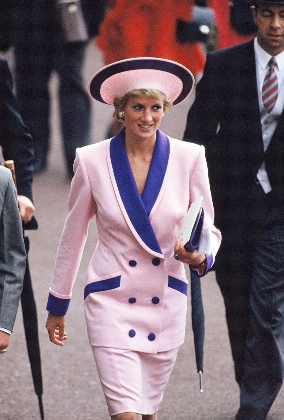 <p>Princess of Wales attends the second day of Royal Ascot in 1990 wearing a now-infamous powder pink suit with purple details. <em>[Photo: Getty]</em> </p>