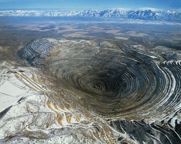 "<p>Over 100 years old, this copper mine includes a <a href=""https://www.mining-technology.com/projects/bingham/"" rel=""nofollow noopener"" target=""_blank"" data-ylk=""slk:2.5-mile-wide pit"" class=""link rapid-noclick-resp"">2.5-mile-wide pit</a> in the Oquirrh Mountains southwest of Salt Lake City, Utah. Considered the <a href=""https://earthobservatory.nasa.gov/images/8144/bingham-canyon-mine-utah"" rel=""nofollow noopener"" target=""_blank"" data-ylk=""slk:largest man-made excavation"" class=""link rapid-noclick-resp"">largest man-made excavation</a>, the mine dips nearly three-quarters of a mile down and covers 1,900 acres. First opened in 1906, the mine is still open and is a National Historic Landmark with a visitor center for folks who want to come and gawk at the hole in the ground that's required intricate planning throughout its decades of use.</p>"