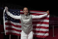 Lee Kiefer of the United States celebrates winning the women's individual Foil final competition against Inna Deriglazova of the Russian Olympic Committee at the 2020 Summer Olympics, Sunday, July 25, 2021, in Chiba, Japan. (AP Photo/Hassan Ammar)