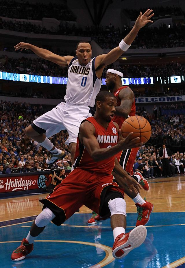 DALLAS, TX - DECEMBER 25: Norris Cole #30 of the Miami Heat dribbles the ball past Shawn Marion #0 of the Dallas Mavericks during the NBA season opening game at American Airlines Center on December 25, 2011 in Dallas, Texas. NOTE TO USER: User expressly acknowledges and agrees that, by downloading and/or using this Photograph, user is consenting to the terms and conditions of the Getty Images License Agreement. (Photo by Ronald Martinez/Getty Images)
