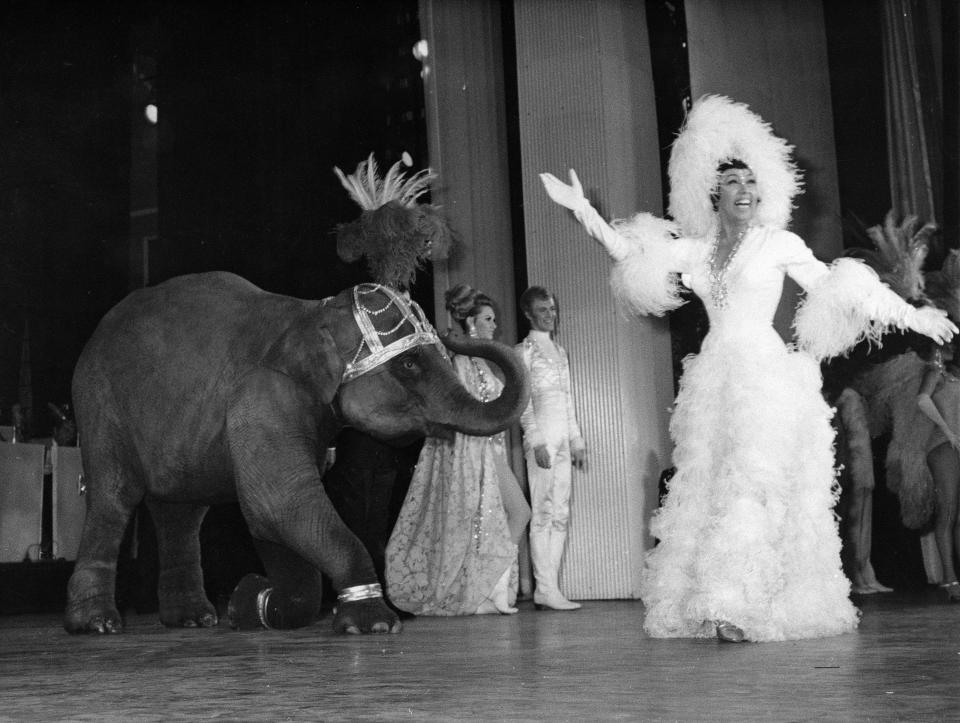 FILE - In this April 4, 1968 file photo, entertainer Josephine Baker appears with a young elephant on stage during her gala premiere at the Olympia Theatre in Paris. The remains of American-born singer and dancer Josephine Baker will be reinterred at the Pantheon monument in Paris, making the entertainer who is a World War II hero in France the first Black woman to get the country's highest honor. Le Parisien newspaper reported Sunday Aug. 22, 2021, that French President Emmanuel Macron decided to organize a ceremony on November 30 at the Paris monument. (AP Photo/File)