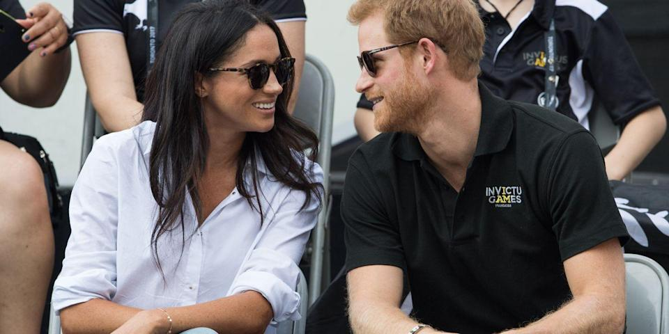 """<p>For the couple's <a href=""""https://www.harpersbazaar.com/celebrity/latest/a12466610/prince-harry-meghan-markle-first-joint-appearance/"""" rel=""""nofollow noopener"""" target=""""_blank"""" data-ylk=""""slk:first joint public appearance"""" class=""""link rapid-noclick-resp"""">first joint public appearance</a>, Meghan Markle and Prince Harry stepped out together for the third day of the Invictus Games in Markle's home-base of Toronto, Canada. The couple appeared comfortable from the get-go, sharing smiles in the front row. </p>"""