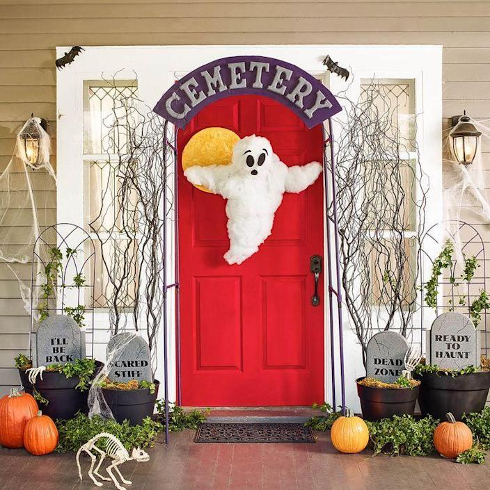 """<p>Create a creepy graveyard gate out of a metal garden arbor flanked by foam-kickboard gravestones. A DIY friendly ghost plus a skulking store-bought <a href=""""https://www.amazon.com/Prextex-Skeleton-Best-Halloween-Decoration/dp/B01F2LXL2K?tag=syn-yahoo-20&ascsubtag=%5Bartid%7C10070.g.2488%5Bsrc%7Cyahoo-us"""" rel=""""nofollow noopener"""" target=""""_blank"""" data-ylk=""""slk:skeleton cat"""" class=""""link rapid-noclick-resp"""">skeleton cat</a>, skeleton arms, and <a href=""""https://www.amazon.com/Halloween-Realistic-Looking-Hanging-Decoration/dp/B071FQ3QNK?tag=syn-yahoo-20&ascsubtag=%5Bartid%7C10070.g.2488%5Bsrc%7Cyahoo-us"""" rel=""""nofollow noopener"""" target=""""_blank"""" data-ylk=""""slk:rubber bats"""" class=""""link rapid-noclick-resp"""">rubber bats</a> complete the scene.</p><p><strong>What You'll Need: </strong><a href=""""https://www.amazon.com/Prextex-Skeleton-Best-Halloween-Decoration/dp/B01F2LXL2K?tag=syn-yahoo-20&ascsubtag=%5Bartid%7C10070.g.2488%5Bsrc%7Cyahoo-us"""" rel=""""nofollow noopener"""" target=""""_blank"""" data-ylk=""""slk:Skeleton cat"""" class=""""link rapid-noclick-resp"""">Skeleton cat</a> ($23, Amazon); <a href=""""https://www.amazon.com/Pair-Halloween-Skeleton-Tongs-Servers/dp/B015KYLMQ6?tag=syn-yahoo-20&ascsubtag=%5Bartid%7C10070.g.2488%5Bsrc%7Cyahoo-us"""" rel=""""nofollow noopener"""" target=""""_blank"""" data-ylk=""""slk:Skeleton arms"""" class=""""link rapid-noclick-resp"""">Skeleton arms</a> ($8, Amazon); <a href=""""https://www.amazon.com/Halloween-Realistic-Looking-Hanging-Decoration/dp/B071FQ3QNK?tag=syn-yahoo-20&ascsubtag=%5Bartid%7C10070.g.2488%5Bsrc%7Cyahoo-us"""" rel=""""nofollow noopener"""" target=""""_blank"""" data-ylk=""""slk:Rubber bats"""" class=""""link rapid-noclick-resp"""">Rubber bats</a> ($9 for 10; Amazon)<br></p><p><strong>GHOST</strong></p><p><strong>1.</strong> Sketch lower portion of ghost body onto white foam core (it should be about 2-feet to 3-feet tall); cut out with utility knife.</p><p><strong>2.</strong> On back of foam core, position 2 skewers as base of arms; duct-tape in place. Duct-tape loop of monofilament at top for hanging.</"""