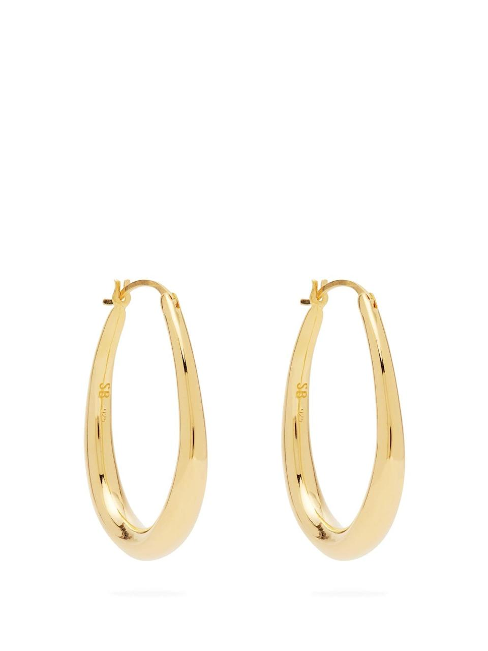 """I could write something really wordy and pseudo-intellectual here, an ode to these hoops. But let's be real, I just like gold hoops. I can never have enough. Sophie Buhai has, once again, nailed the perfect statement hoop which means I can be super lazy and just wear jeans and a white T-shirt while still looking like I've made an effort. Simple and effective. Not sure I can justify them right now because I have approx 15 pairs of gold hoops in my possession but…if I could...I would. <br><br><strong>Sophie Buhai</strong> Tiny Egg Gold Vermeil Hoops, $, available at <a href=""""https://www.matchesfashion.com/products/1339018?"""" rel=""""nofollow noopener"""" target=""""_blank"""" data-ylk=""""slk:Matches Fashion"""" class=""""link rapid-noclick-resp"""">Matches Fashion</a>"""