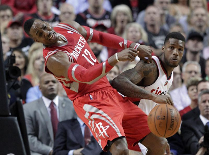 Houston Rockets center Dwight Howard, left, and Portland Trail Blazers forward Dorell Wright collide during the first half of Game 3 of an NBA basketball first-round playoff series in Portland, Ore., Friday, April 25, 2014. (AP Photo/Don Ryan)