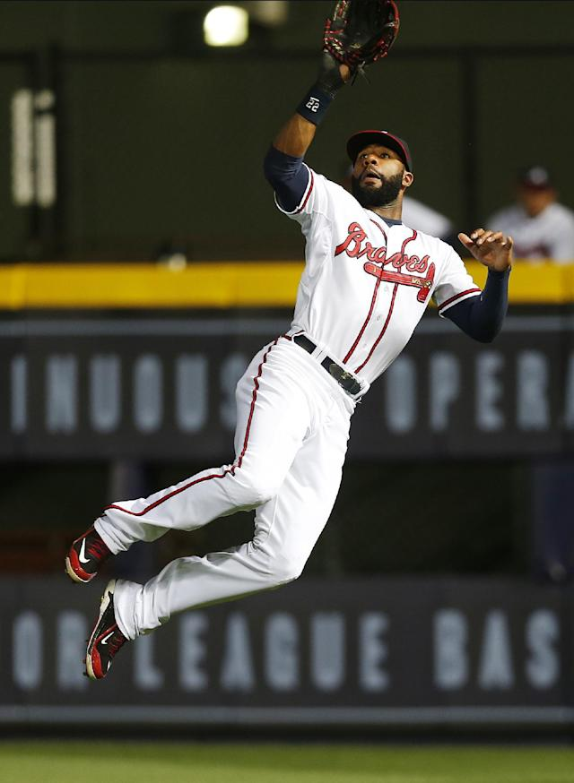 Atlanta Braves right fielder Jason Heyward (22) makes leaping catch for an out on a line drive hit by Chicago Cubs' John Baker in the sixth inning of a baseball game on Friday, May 9, 2014, in Atlanta. (AP Photo/John Bazemore)