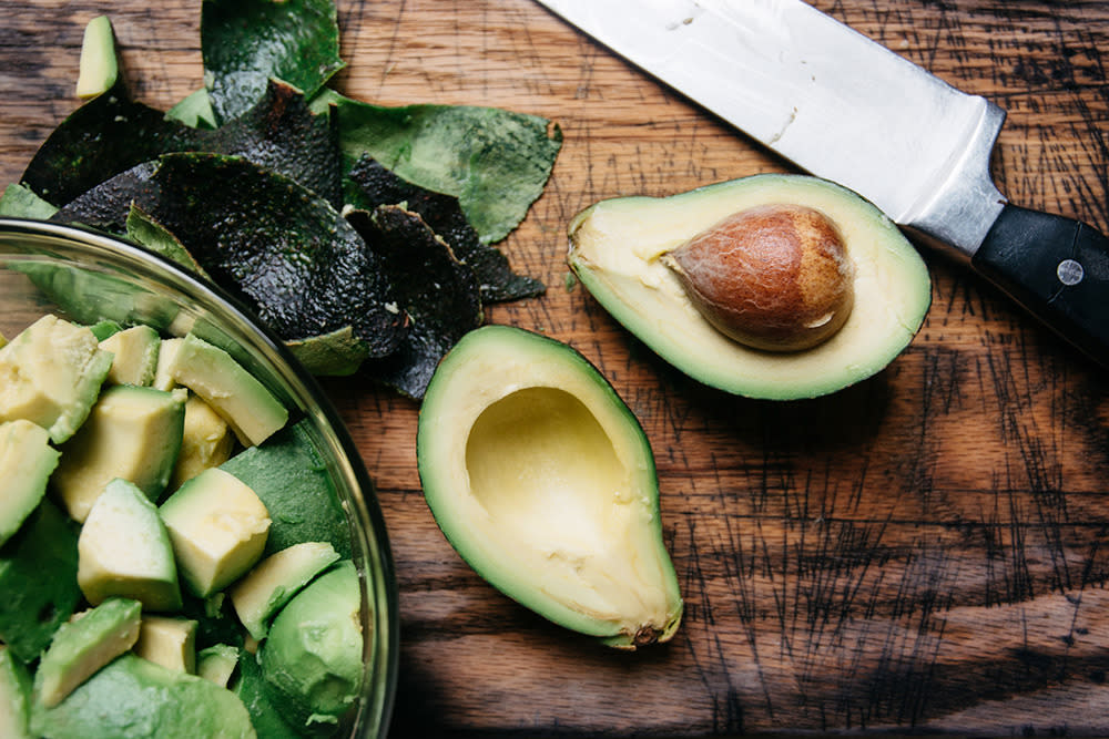 "<p>""They're full of satisfying, healthy fat,"" Keri Glassman, registered dietitian and founder and president of <a href=""http://nutritiouslife.com"">Nutritious Life</a>, a New York City nutrition consulting practice, tells Yahoo Health. Avocados also contain fiber and other good-for-you compounds such as the antioxidant glutathione, which helps block the absorption of some bad fats, notes Glassman.</p><p><i>(Photo: Stocksy)</i></p>"