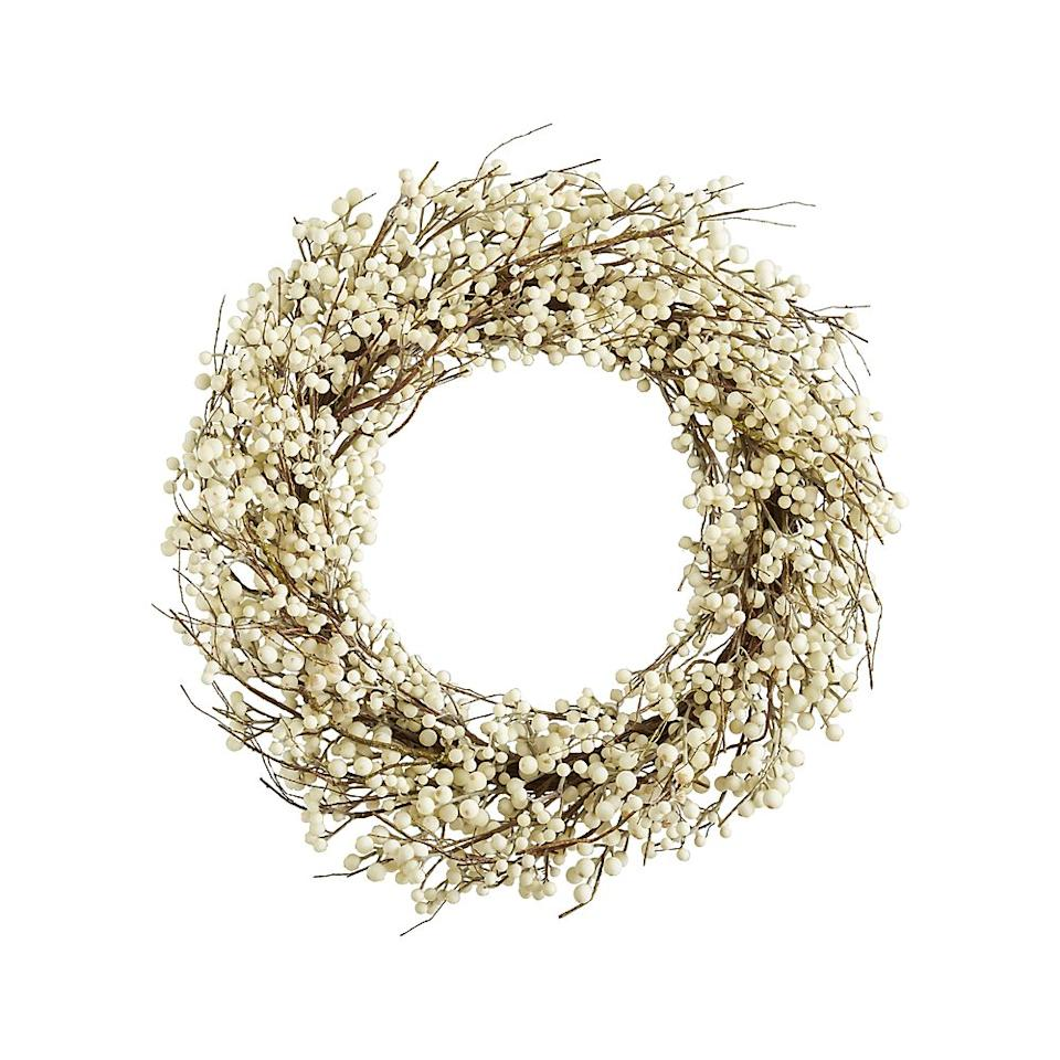 "<p><strong></strong></p><p>crateandbarrel.com</p><p><strong>$99.95</strong></p><p><a rel=""nofollow"" href=""https://www.crateandbarrel.com/white-ilex-berry-wreath/s321784"">Shop Now</a></p><p>Can't bear to mix up your mod decor for Christmas? Opt for an elegant all-white wreath instead.</p>"