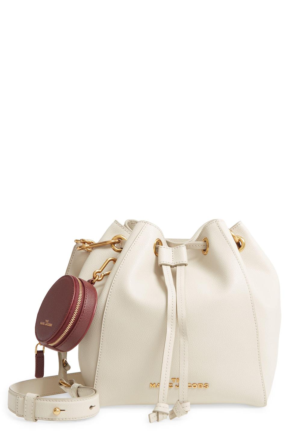 """<p><strong>THE MARC JACOBS</strong></p><p>nordstrom.com</p><p><strong>$297.00</strong></p><p><a href=""""https://go.redirectingat.com?id=74968X1596630&url=https%3A%2F%2Fwww.nordstrom.com%2Fs%2Fthe-marc-jacobs-the-bucket-bag-leather-crossbody-bag%2F5608622&sref=https%3A%2F%2Fwww.elle.com%2Ffashion%2Fshopping%2Fg34741930%2Fnordstrom-12-days-of-cyber-savings-sale%2F"""" rel=""""nofollow noopener"""" target=""""_blank"""" data-ylk=""""slk:Shop Now"""" class=""""link rapid-noclick-resp"""">Shop Now</a></p>"""