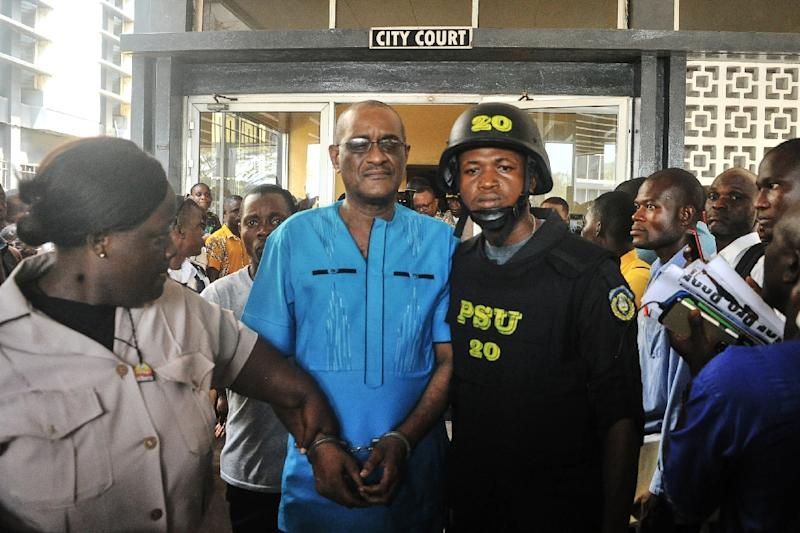 Former deputy governor of the Central Bank of Liberia Charles Sirleaf (C) has been charged with criminal conspiracy over the handling of billions of Liberian dollars in a banknote printing scandal (AFP Photo/Zoom DOSSO)